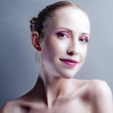 Beautiful young adult woman portrait, looking at camera Standard-Bild