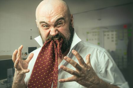 Funny man portrait with office manager eating his tie