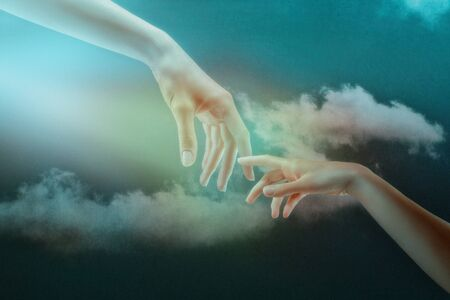 Humanity. Abstract backgrounds. Couple of hands against the skies