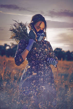 Poisoned Morning. Apocalyptic female portrait in the summer meadow Standard-Bild