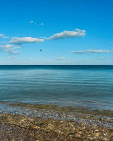 Calm sea under blue skies, natural seasonal landscape