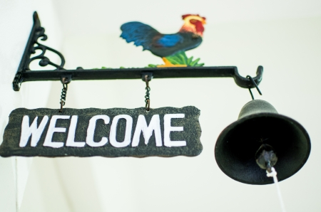 Welcome Sign with small bell, Thailand photo