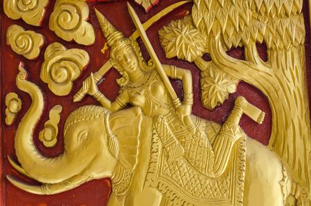 Thai stye carving texture in buddish church s wall photo