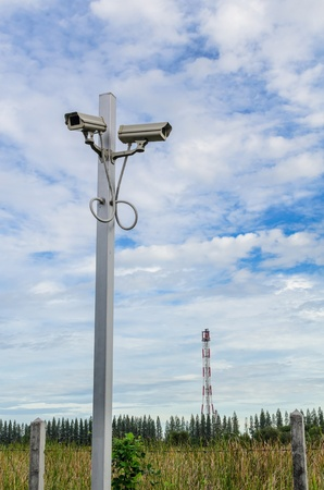 The CCTV with blue sky and the white cloud background photo