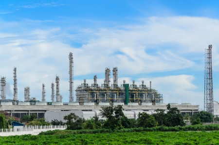 Petrochemical plant with the cassava trees foreground in Thailand
