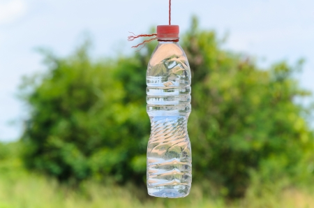 environmental conversation: Plain water in the bottle suspended by rope