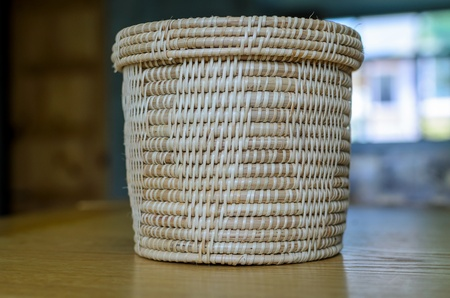 Wicker tissue box put on the dinning table photo