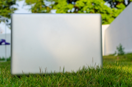 Computer laptop put on the grass