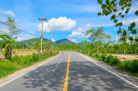 Road with blue sky and mountain backgrond photo