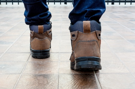 safety shoes: Safety shoes with forward step walking Stock Photo