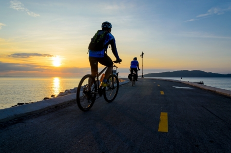 Bicycle ride with morning sun rise near the sea, Thailand photo