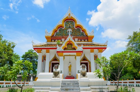 Buddhist church with blue sky background in Thailand photo