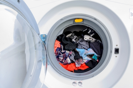 Washing machine with many shirts inside photo
