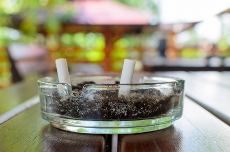 Ashtray put on the table with nice bokeh background