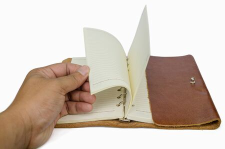 Hand open the leather cover photo