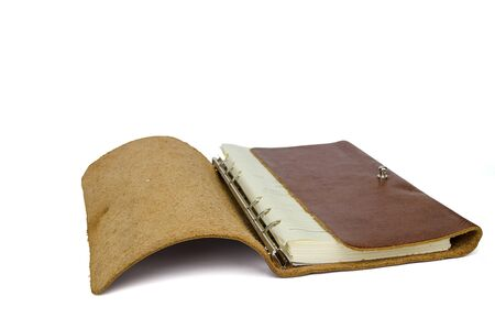 Brown leather notebook isolated on white background with clipping path photo