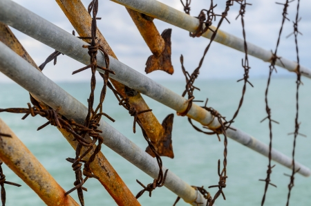 wire fence on the beach, Thailand photo