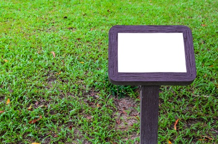 Blank wooden board in the park photo