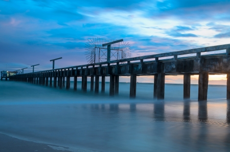 Bridge to the sea with sunset bihind, in east of Thailand