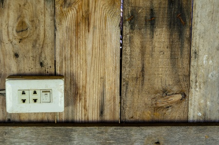 Old electrical switch on old wood background photo