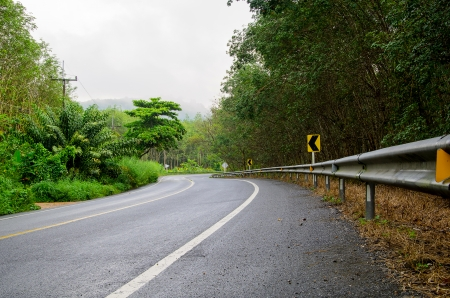 Road the mountain with fog, east of Thailand photo