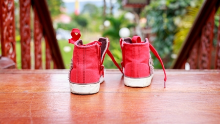 Red shoes ready to go outside