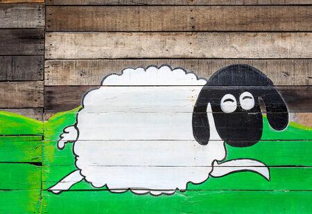 Fundo de madeira com uma pintura ovelhas, Tail