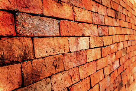 Brick wall with diminishing perspective view photo