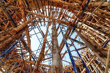 Wood scaffolding in the construction site with blue sky  Stock Photo
