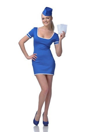 air hostess: Air hostess holding two tickets to the flight