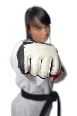 taekwondo: Taekwondo. Woman in a kimono isolated on the white background Stock Photo