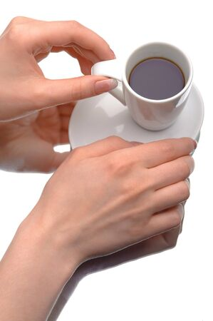 Two hands holding a coffee cup on white