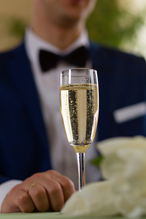 a glass of champagne on the table of the newlyweds close-up on clearance