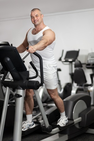 Man running on a treadmill in a gym  photo