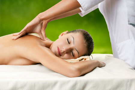 Healthy spa  young beautiful relaxing woman having moistening mask applied