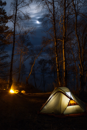 Tent and campfire at moon night