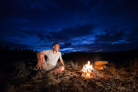 Tourist looking at fire