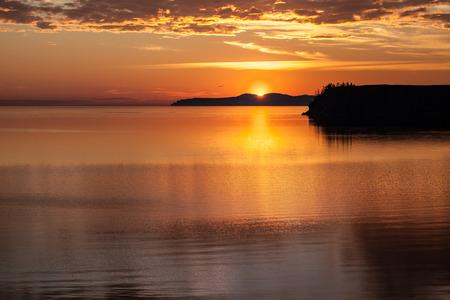 brilliant colors: Sunrise above lake with brilliant colors