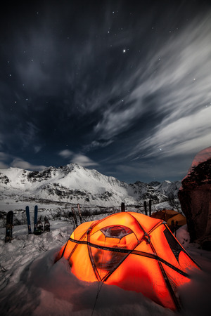 Orange tent  Snow mountains Stock Photo
