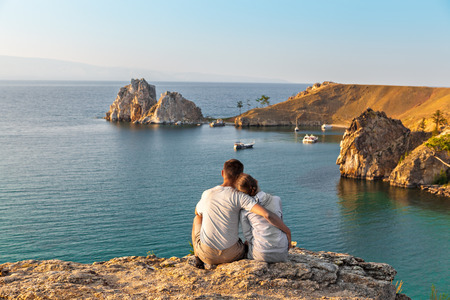 Two tourists looking at beautiful view of Baikal lake Imagens