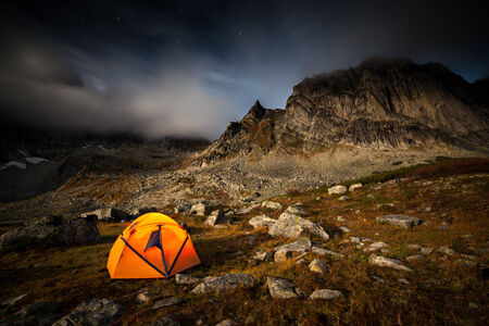 Tent near mountain at moon night photo