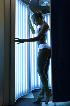 Woman getting tan in the solarium