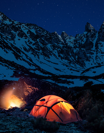 Camping in the mountains at stars night Stock Photo