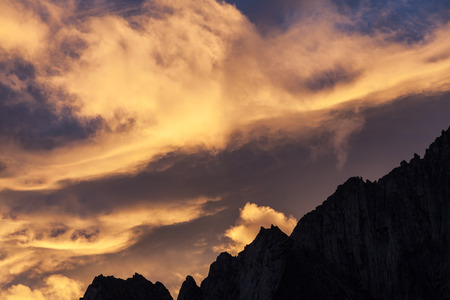 stormy clouds: Stormy clouds above mountain peaks