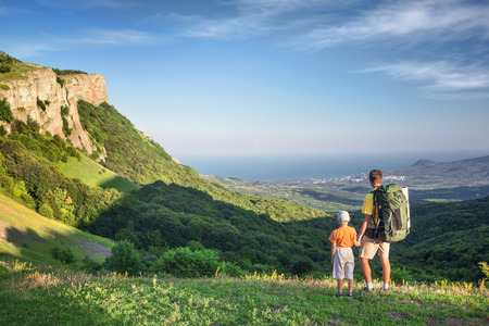 Father with his son hiking