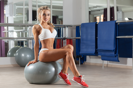 big ball: Woman is sitting on a big ball at the gym