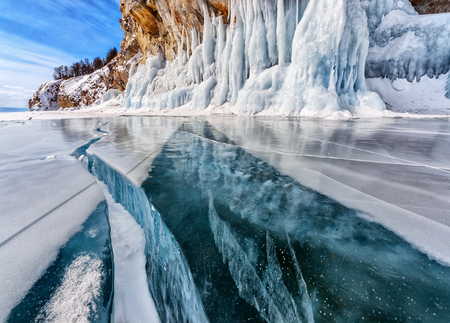 Winter frozen ice. Lake Baikal. Global warming Banco de Imagens