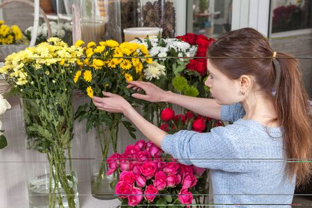 caring for: Florist caring for flowers in the shop