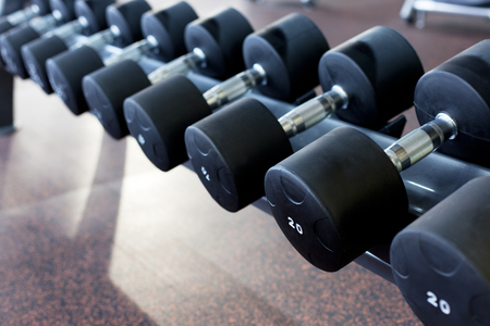 staying in shape: many dumbbells are on stand at the gym