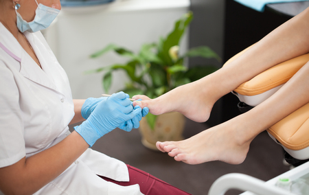 fungal: woman foot treating for fungal nail in pedicure